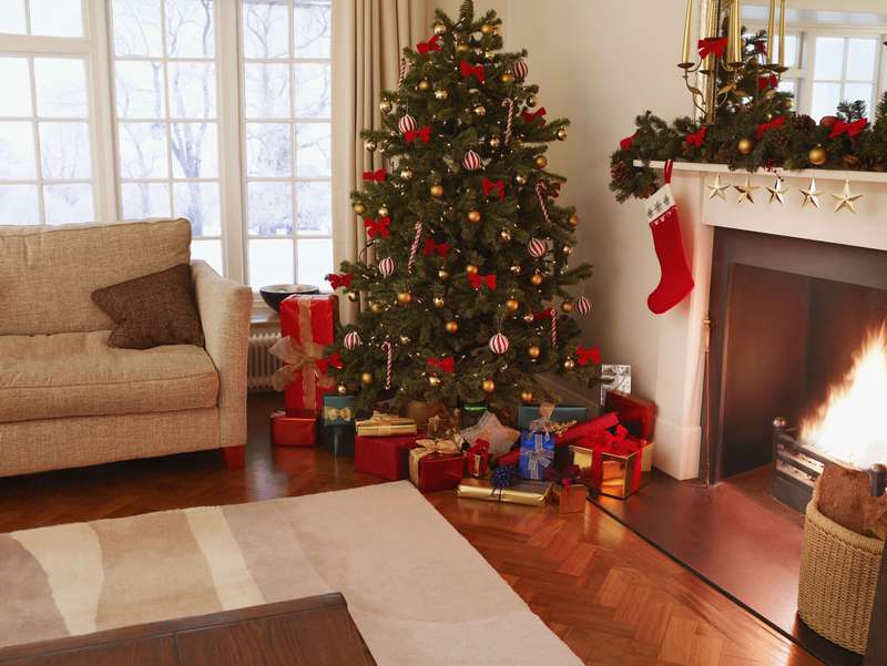 Living romm with Christmas tree, gifts and decorations