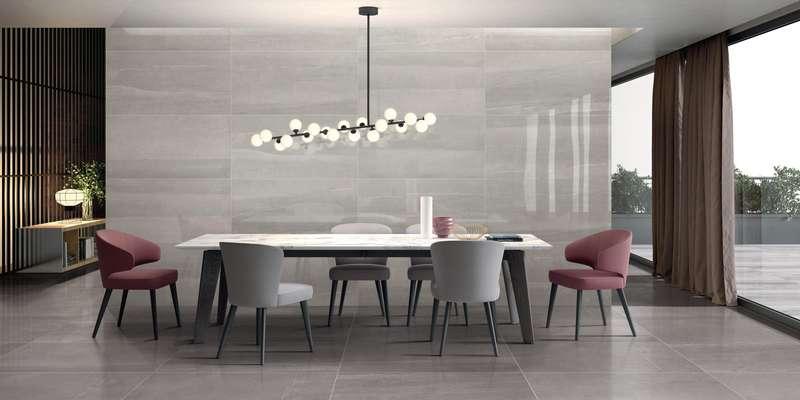 Salle à manger avec grande tuile de céramique mural et au sol