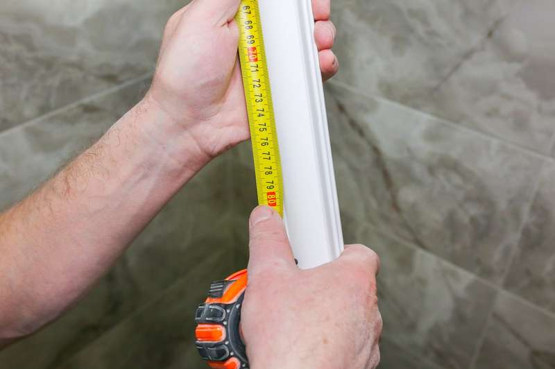 Measuring a white moulding